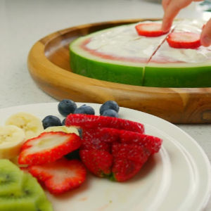 watermelon pizza for kids - adding fruit topping